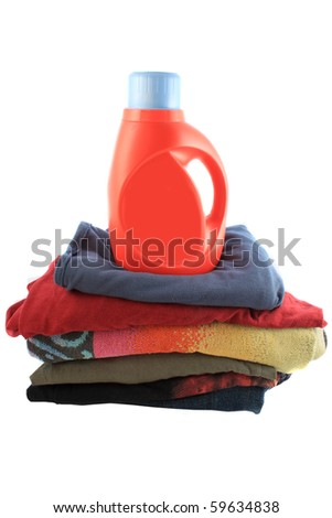 Liquid laundry detergent on top of folded pile of clothes
