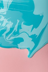 Liquid marbling blue paint background. Fluid painting abstract texture on pink paper. Colorful mix of acrylic vibrant colors, copy space