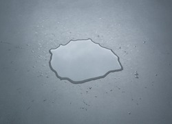Liquid or water drops splash on the floor , Dark color tone, abstract background