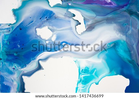 Liquid paper aquamarine and blue paint background. Fluid painting abstract texture, art technique. Colorful mix of acrylic vibrant colors. Creativity and painting. Background design, printing, pattern
