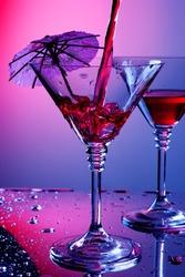 Liquid pouring into martini glass