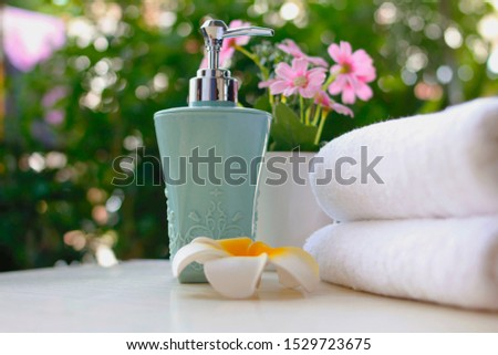 Liquid soap bottles placed on the table are natural tree backdrops for the spa.