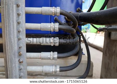 Liquid tight flexible conduit connected with Rigid Steel Conduit (RSC) Stock photo ©