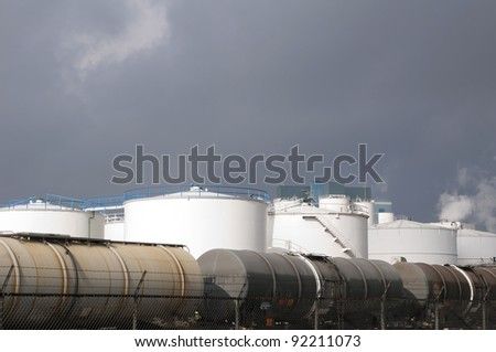 liquid train wagons and oil and fuel storage tanks