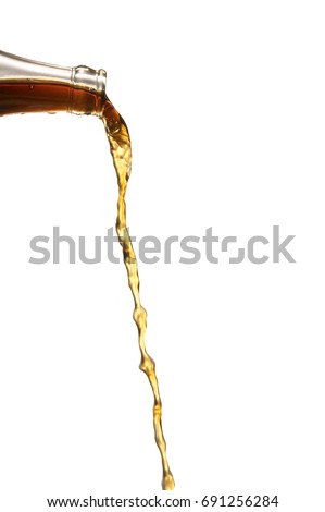 liquid  was poured from a bottle on a white background.