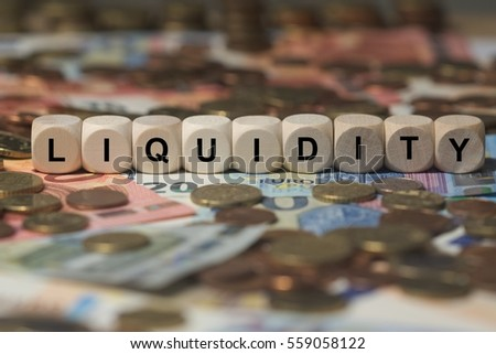 liquidity - cube with letters, money sector terms - sign with wooden cubes Foto d'archivio ©