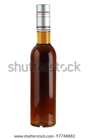 Liquor in a glass bottle isolated on a white background.