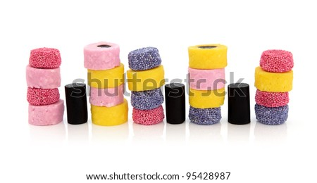 Liquorice allsort sweets in colorful abstract stack design isolated over white background. - stock photo