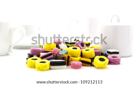 Liquorice allsort sweets in colourful abstract stack design in modern white kitchen setting