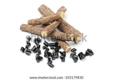 liquorice roots with black pieces, on white background