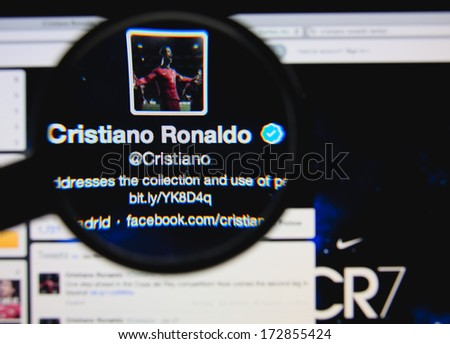 LISBON - JANUARY 23, 2014: Photo of Cristiano Ronaldo's official twitter page on a monitor screen through a magnifying glass.