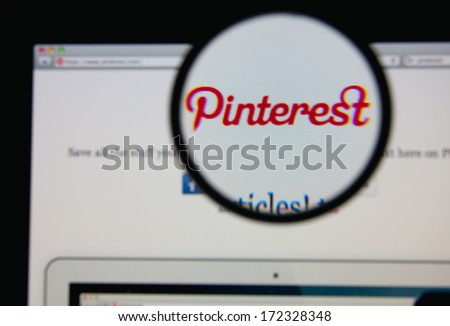 LISBON JANUARY 20 2014 Photo of Pinterest homepage on a monitor screen through a magnifying glass