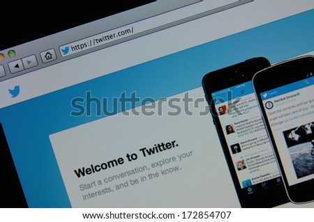 LISBON - JANUARY 23, 2014: Photo of Twitter homepage on a monitor screen. Twitter is an online social networking and microblogging service. - stock photo