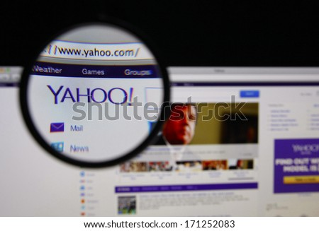 LISBON - JANUARY 14, 2014: Photo of Yahoo homepage on a monitor screen through a magnifying glass.