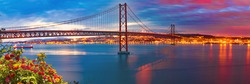 Lisbon landscape at sunset.Panoramic photograph of the 25 de Abril bridge in the city of Lisbon over the Tajo River.