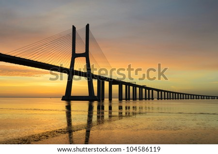 LISBON - MAY 13: Vasco da Gama bridge during sunrise on May 13, 2012 in Lisbon, Portugal. Vasco da Gama bridge is 17.2 km long and is the longest bridge in Europe.