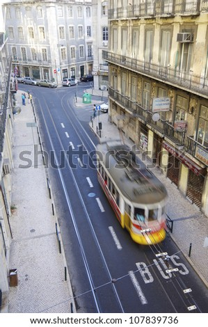 LISBON, PORTUGAL - AUGUST 18: Tram on August 18, 2006 in Lisbon: a typical tram through one of the streets of old city. These trams are one of the most popular tourist attractions.