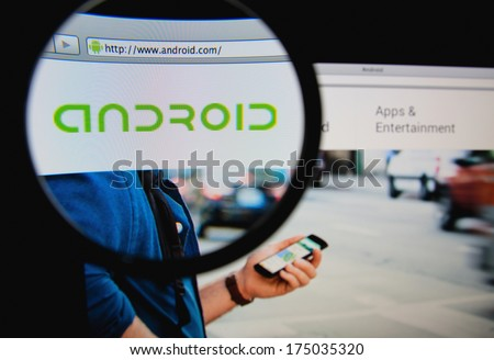 LISBON PORTUGAL FEBRUARY 5 2014 Photo of Android homepage on a monitor screen through a magnifying glass
