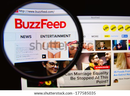 LISBON PORTUGAL FEBRUARY 19 2014 Photo of BuzzFeed homepage on a monitor screen through a magnifying glass BuzzFeed is a social news and entertainment website