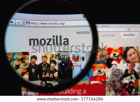 LISBON, PORTUGAL - FEBRUARY 17, 2014: Photo of Mozilla homepage on a monitor screen through a magnifying glass. Mozilla is a free software community best known for producing the Firefox web browser.