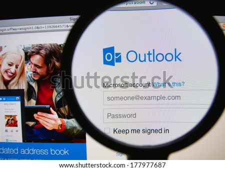 LISBON PORTUGAL FEBRUARY 21 2014 Photo of Outlook homepage on a monitor screen through a magnifying glass