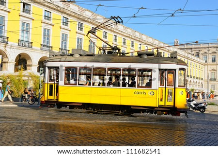 LISBON, PORTUGAL - JULY 25: Old trams on the street of Lisbon, Portugal at July 25, 2012. The trams were imported from the United States in 1901 to replace horse-drawn carriages.