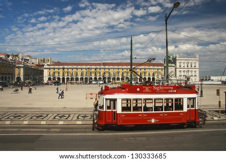 LISBON, PORTUGAL - MAY 7, 2008: Red sightseeing tram starts from downtown Commerce square Lisbon on May 7, 2008. Trams keep traditional style of town's historic center