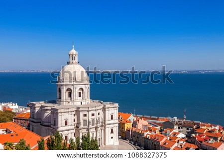 Lisbon, Portugal. Panteao Nacional aka Igreja de Santa Engracia Church Alfama District rooftops and Tagus River Estuary. The National Pantheon is a 17th century baroque monument