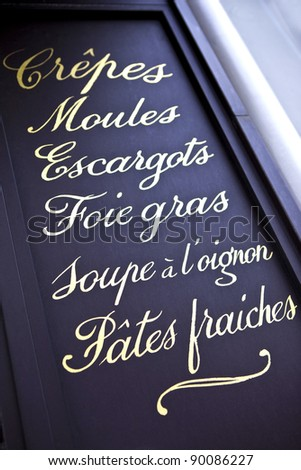 List of dishes on the facade of a Parisian bistro