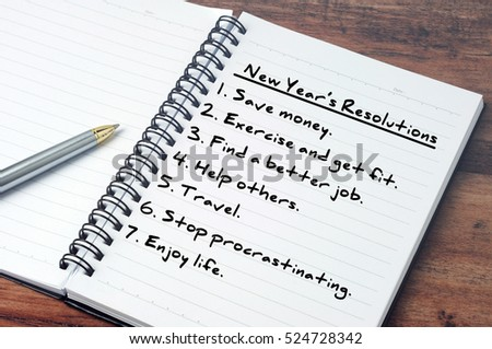 List of New Year\'s resolution on notepad, vintage style.