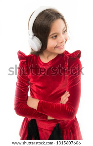 Listen for free new and upcoming popular songs right now. Music always with me. Little girl listen music wireless headphones. Online music channel. Girl little child use music modern headphones. #1315607606