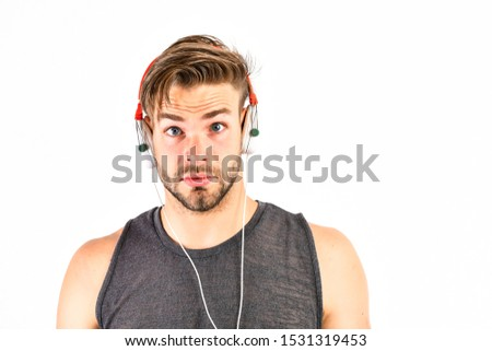 Listen music for motivation and inspiration. Audio quality. Audio track. Man handsome unshaven hipster listening audio file using headphones gadget. Modern earphones concept. Audio education.