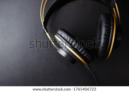 Listen to musical tracks with professional headphones.Big black stereo headset with hifi sound for audiophile and sound enthusiast.Enjoy listening to new music in high quality with head monitors