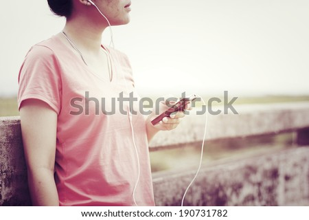 Listening Music - Young girl listening to music with retro filter effect