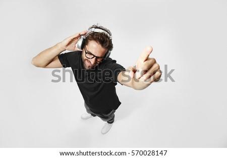 Listening to music in white studio