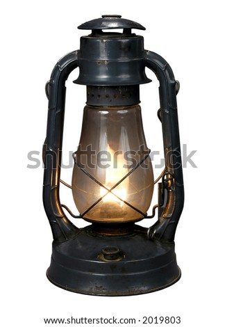 Lit Antique oil lamp with clipping path