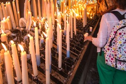 lit candles at the Marian shrine in Lourdes, France
