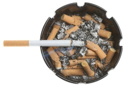 Lit cigarette in a full ashtray.