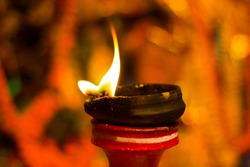 lit clay lamp on top of a clay stand or worship idol durgapuja india diwali