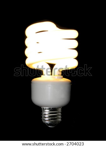 lit compact fluorescent light bulb isolated on black stock photo 2704023 shutterstock. Black Bedroom Furniture Sets. Home Design Ideas