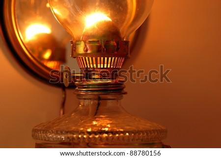 lit golden kerosene lamp details closeup macro