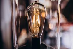 Lit lightbulb in the dark room