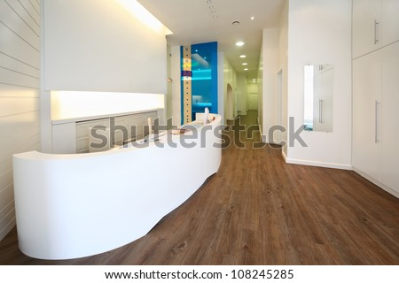 Lit reception area in dental clinic. Empty workplace with table with computer.