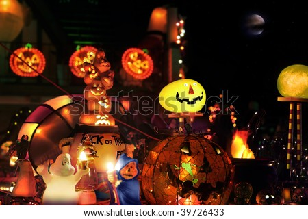 Lit up stylized halloween composition of warm glowing spooky fun figures against black