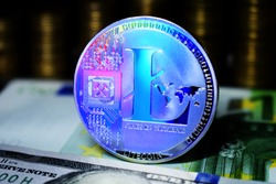 Litecoin LTC is surrounded by a money background.