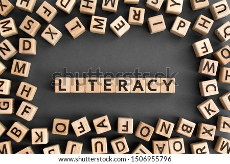 literacy - word from wooden blocks with letters, basic skill or knowledge literacy concept, random letters around, top view on wooden background Сток-фото ©