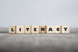 LITERACY word made with building blocks