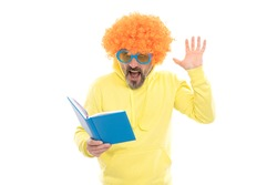 Literary fan. Surprised nerd in wig read book. Examination in literary English. Reading foreign literature. School library. Literacy education.