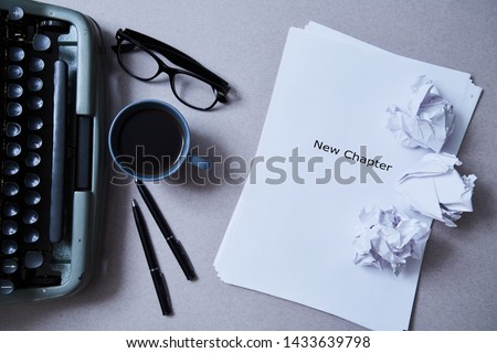 Photo of Literature, author and writer, writing and journalism concept: typewriter, cup of coffee and glasses and a paper