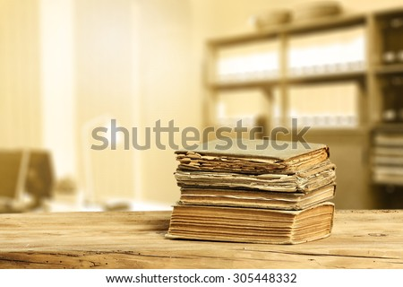 literature on desk of wood and interior of office